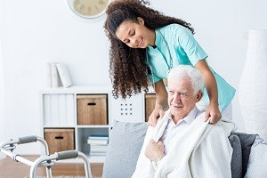 Doctor helping senior man