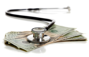 A stethoscope and American money on a white background - Healthcare cost concept