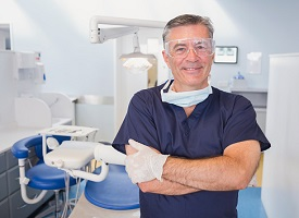 Portrait of a smiling dentist with arms crossed