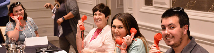 Smiling Senior-Level Creditors Practice Phones at CRS