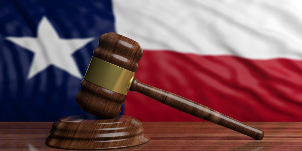 Judge or auction gavel on Texas US of America waving flag background. 3d illustration