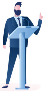 Man standing and speaking in front of podium